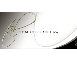 TOM CURRAN logo
